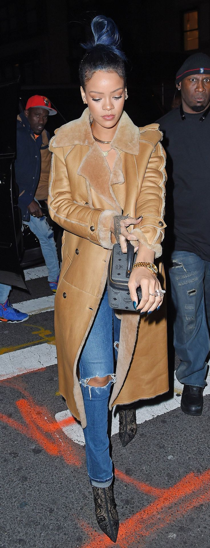 Rihanna puts a decidedly fashion-forward spin on the shearling coat in this Chanel number