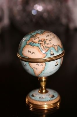 "Limoges Globe. Just can't get over some of the stuff I used to carry. Maybe that's the reason I've written books for retailers.  This would have fit equally well on the ""Lovin' Travel"" bulletin board, too!"