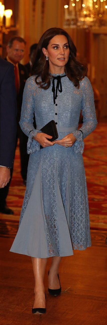 Catherine, Duchess of Cambridge looks elegant in a pretty blue hue Temperley London eclipse lace collar dress with flared cuffs and pretty pleats which are spliced with cotton panels, with the velvet ties and button details in contrasting black. She paired with a black suede heels and a small clutch bag, to co-host the reception at Buckingham Palace for the World Mental Health day.