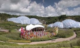EDEN PROJECT (CORNWALL) Wide shot of Eden Project site with flags fluttering in breeze