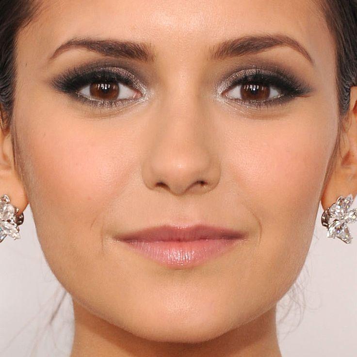 Vampire Diaries star Nina Dobrev wore gunmetal gray smoky eyes to the Elton John AIDS Foundation Academy Awards viewing event.