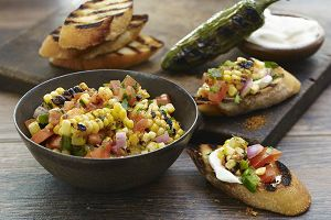 Grilled corn, jalapeño pepper and the great taste of OLD BAY perk up the flavour of pico de gallo in this colourful DIY-bruschetta.