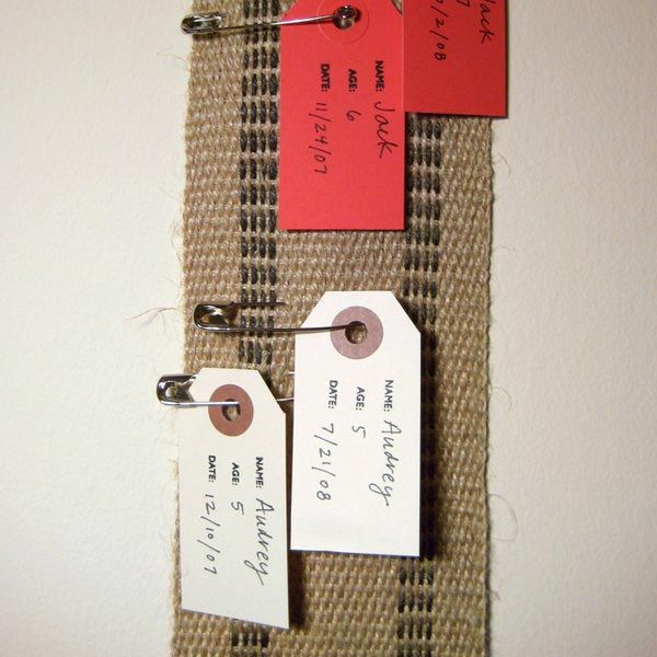 Rustic homemade growth chart - thick woven ribbon, record their height by safety pinning tags with date/age/child's name. maybe color-coded tags or different tag shapes for each child?