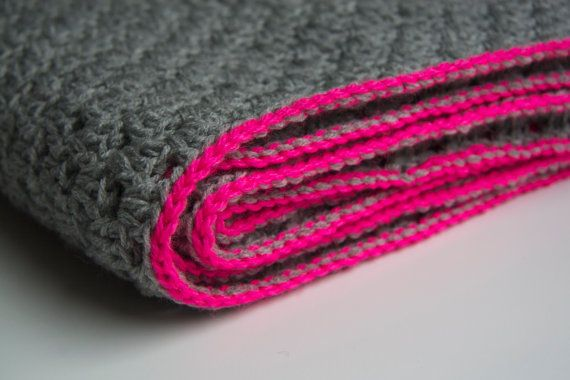Grey granny square blanket with neon pink