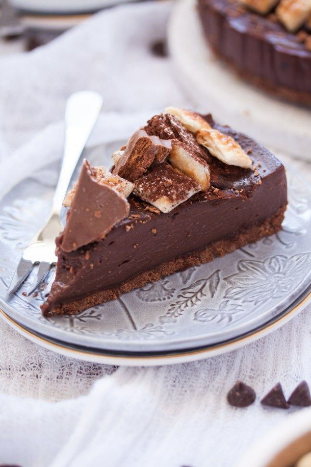 This Tim Tam Chocolate Custard Slice is a base of crushed Tim Tam biscuits, a layer of chocolate custard, crumbled Tim Tams and sweet puff pastry pieces. #timtams #custardslice