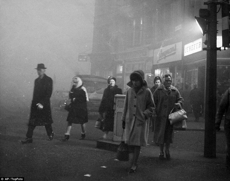 The Great Smog of London of 1952: Commuters pictured wearing extra layers to work to protect them from the dust and dirt on their way to work as London entered its second day of dense fog in 1952