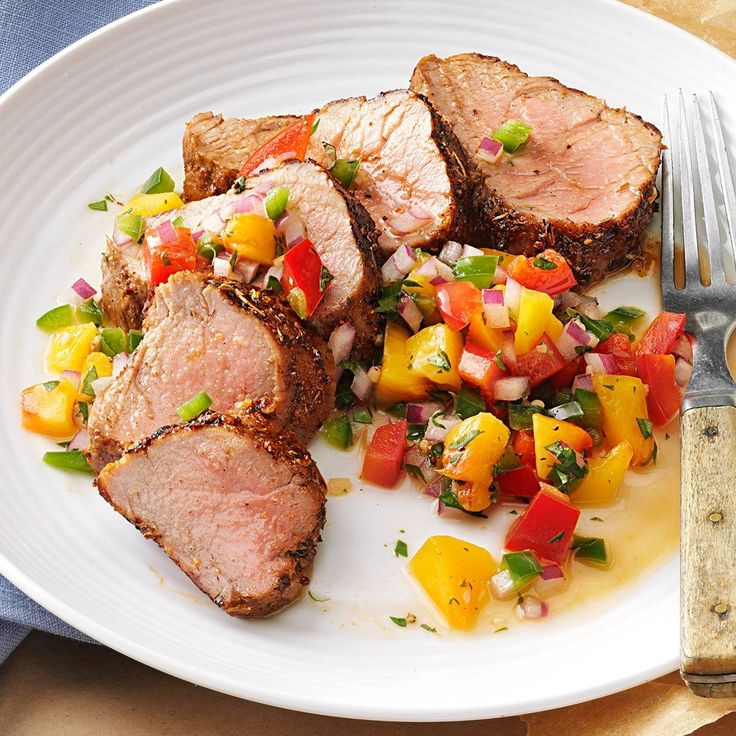 Caribbean-Spiced Pork Tenderloin with Peach Salsa Recipe -I love this recipe because of the depth of flavors and burst of colors. It's quick and easy to make. It's best when peaches are in season, but you could try strawberries or pineapple instead. —Holly Bauer, West Bend, Wisconsin