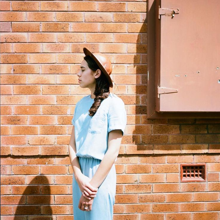 @modestlyrose in casual: Blue chambray jumpsuit, brown leather hat. Image by: @beardeerfox.