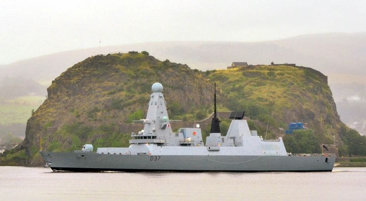 Duncan passes Dumbarton Castle on her way down the Clyde. HMS Duncan profiled on her contractor trials.