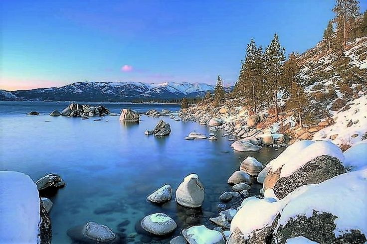 Lake Tahoe, Those snow-capped mountains that awe travelers enjoying the lake in the warm summer months become ski resorts in the winter.