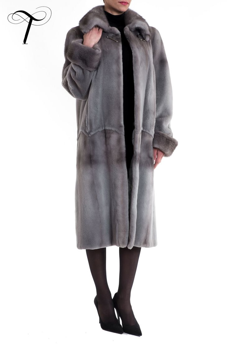 SHEARED MINK LONG COAT  A #classic, #timeless design, this blue irish #coat, tailored by #toutountzisfurs, is going to be the perfect finish for your #winter appearance. Cut in a straight line, it is crafted from sheared #mink #fur while the collar and cuffs are made from plush long-haired #minkfur. The #furcoat is adorned with a broch-style button. Easily paired with any #outfit, it will be easy to wear providing simultaneously #glamour and #style. #fashion #furfashion #fourrure #mexa #chic