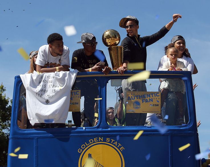 . Golden State Warriors\' Stephen Curry, along with his wife Ayesha and daughter Riley, 2, to the right, ride a float along Broadway during the team\'s NBA championship victory parade in downtown Oakland, Calif., on Friday, June 19, 2015. (Jane Tyska/Bay Area News Group)