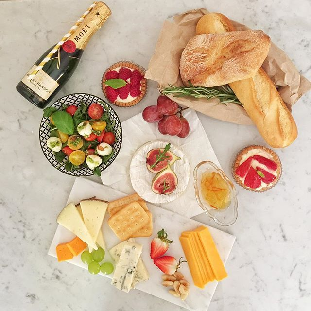 "We are in love with our ""Eat. Drink. Man. Woman."" #picnic Delicious cheese, homemade chutney, fresh baguette, caprese salad with pesto dressing and dessert  #moëtchandon #bestpicnicever #flatlays #flatlaystyle"