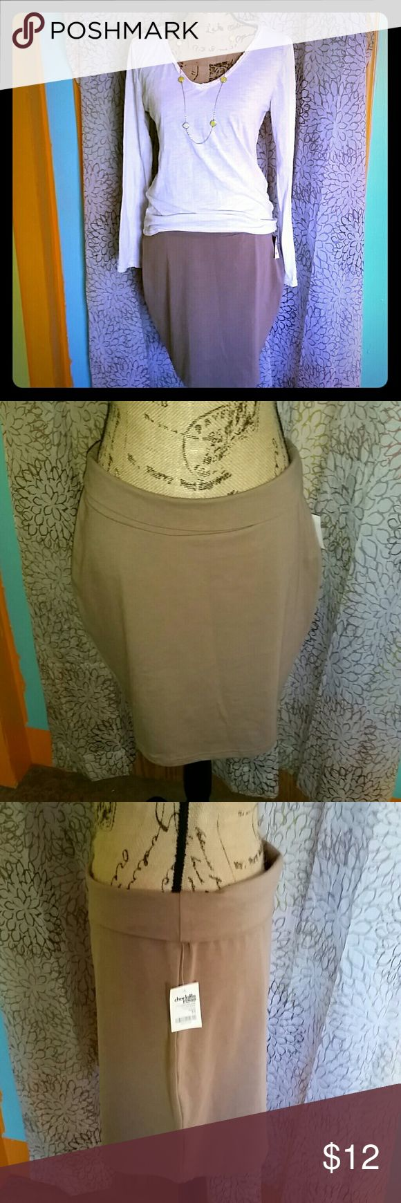 NWT Charlotte Russe tan skirt Beautiful tan skirt NWT Charlotte Russe. Very fashionable. Can be worn to work with leggings ot tights. Then straight to a night out on the town! Simply a must have this spring thru summer! Bundle and save. Happy poshing!! Charlotte Russe Skirts