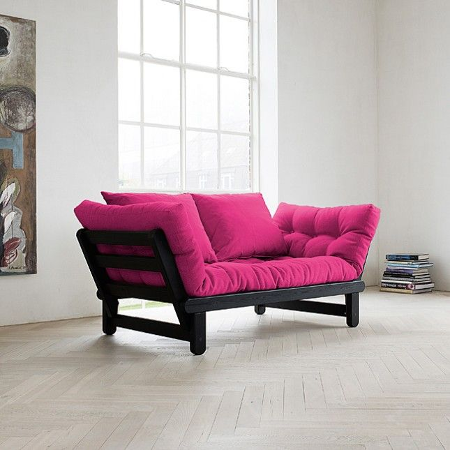 Add a pop of color to your room with this magenta futon.