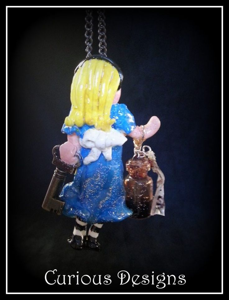 This is the back of Alice she is holding a key and a bottle of drink me this is a story piece from Lady Ophelia Raven Loves adventures.  http://ladyopheliaravenlovelace.blogspot.co.uk/ https://www.facebook.com/pages/Curious-Designs/353536071461624?sk=info #steampunk #aliceinwonderland #ladyopheliaravenlovelace #curiousdesigns #jewellery #necklace