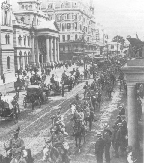 South African Light Horse, coming down Adderley Street  to entrain for the front, Cape Town (SANMMH)