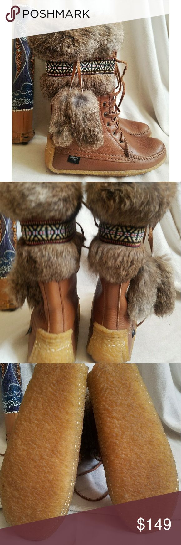 Laurentian Chief handmade boots Laurentian Chief ladies boots, hand made in Canada by Native Americans, leather with Rabbit Fur, two large rabbit poms per boot, lined in the finest white shearling wool, plantation gum sole, leather laces, beautiful braided detail breaks up the rabbit fur. These boots are in good to excellent condition.May have a few faint spots on leather in places, and faint marks to side of soles.Ladies size 8. *My items are NOT from a smoke free home* Laurentian Chief…