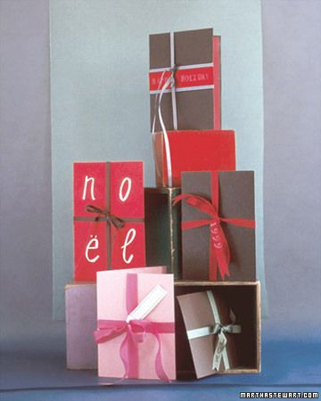 """Dressing a card as a present is as easy as tying a bow. These ribbon-tied cards can be decorated as simply or as elaborately as you wish. We added a gift tag to a card tied with pink seam binding; on another, """"noel"""" is spelled out in large letters written in opaque white ink.Homemade Christmas Cards, Diy Crafts, Holiday Cards, Gift Cards, Martha Stewart, Cards Diy, Cards Tutorials, Diy Christmas Cards, Handmade Christmas Cards"""