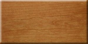 Cherry veneer with clear lacquer finish.