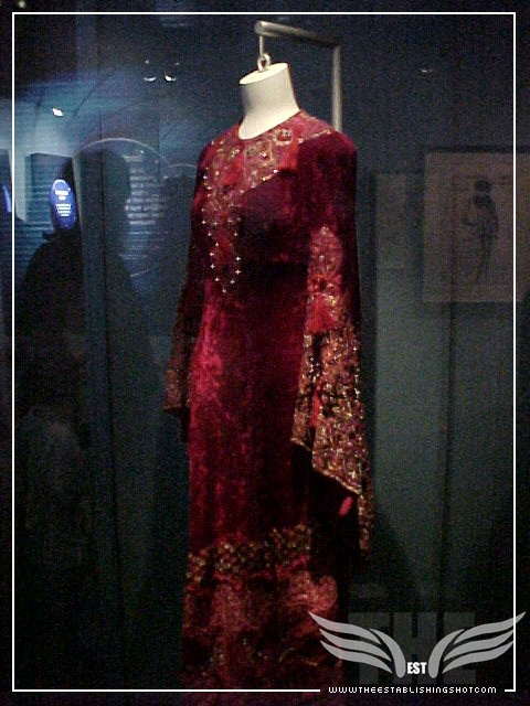 The Establishing Shot: James Bond Exhibition - Jane Seymour's Solitaire Red velvet maxi dress from Live and Let Die - Science Museum, London