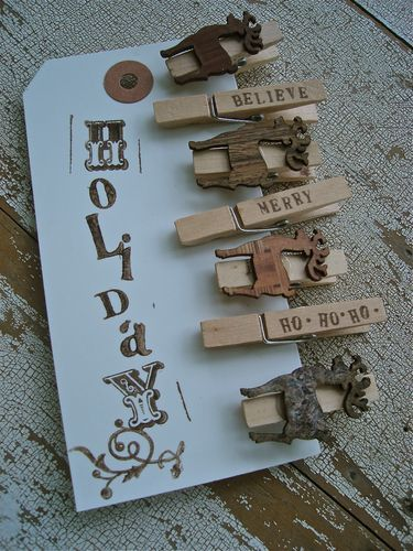 Rubber stamp new clothes pins and use them to string up your X-mas cards with rope or old measuring tape!