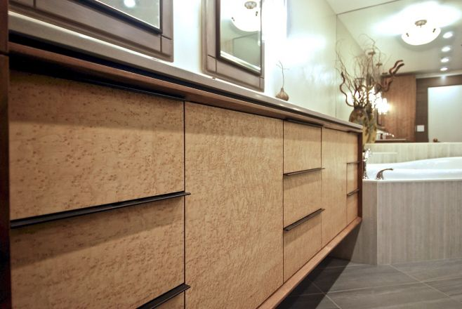 Sleek, modern cabinets make a stunning master bath. Designed and created by Olde World Artisans.