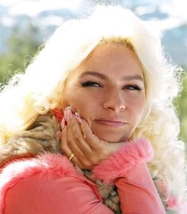 I love her. She's delightfully tacky, yet unrefined :) Beth Chapman- Dog the Bounty Hunter