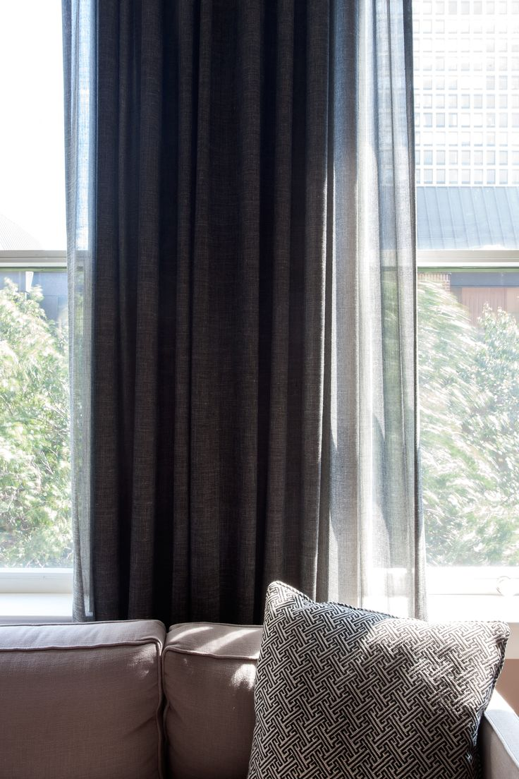 Hospitality and hotel window treatments sheer shades solar screen - Decorative Drapes Mounted Between Windows Which Adds Depth By Creating A Column Effect While Keeping