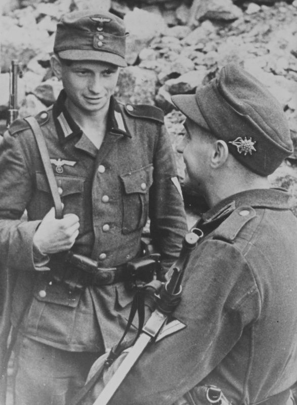 Two mountain huntsman Wehrmacht position on the Kola Peninsula The uniforms change, but not so much the young men that fill them. These are German Mountain Troops.