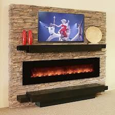 A Wall Mounted Electric Fireplace Looks Stunning Sandwiched Between Two  Mantel Shelves.