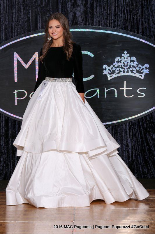Audrey Eckert represented her home state of Nebraska at the 2016 Miss American Coed Jr. Teen pageant in this enchanting black and white evening gown!  The Color  Audrey's evening gown features two of the most popular evening gown colors of 2016. This color blocking combination is a little mature for a Jr. Teen contestant; however, the design of the gown keeps the look youthful.  This color combination complements Audrey's lightly bronzed skin and brunette locks perfectly.