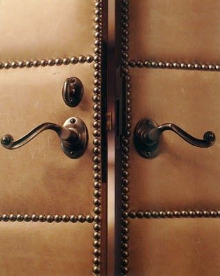 Studded door... this would be so easy to DIY.  Cheap door, batting, fabric, studs=AWESOME!