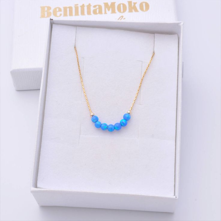 Minimal Opal Necklace, Minimal Gold Necklace, Delicate Necklace, Dainty Necklace, Opal Necklace, Opal Choker, Gold Choker, Minimal Gold Choker, Gold Choker, Simple Gold Necklace, Blue Opals, Blue Opal Necklace *** A dainty a pretty Blue opal necklace. Gift for mom, sister, girlfriend, best friend. Perfect for everyday wear and looks great with other necklaces.  - Gold Filled chain - 7 Opal Beads 3mm diameter - Nickel Free  More of my jewelry you can see here: https://www.etsy.com&#x...