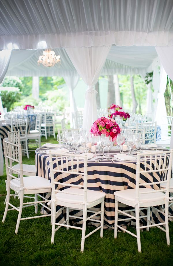 blue and white striped linens with pink centerpieces