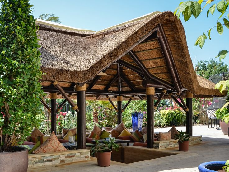 A swimming pool we transformed into a outdoor haven! Perfect for entertaining!  www.capereed.com #Home #Villa #Gazebo #Thatch