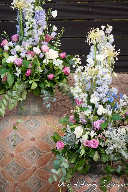 flower arrangements ancient  greek vases . Cleopatra's Weddings and Event management