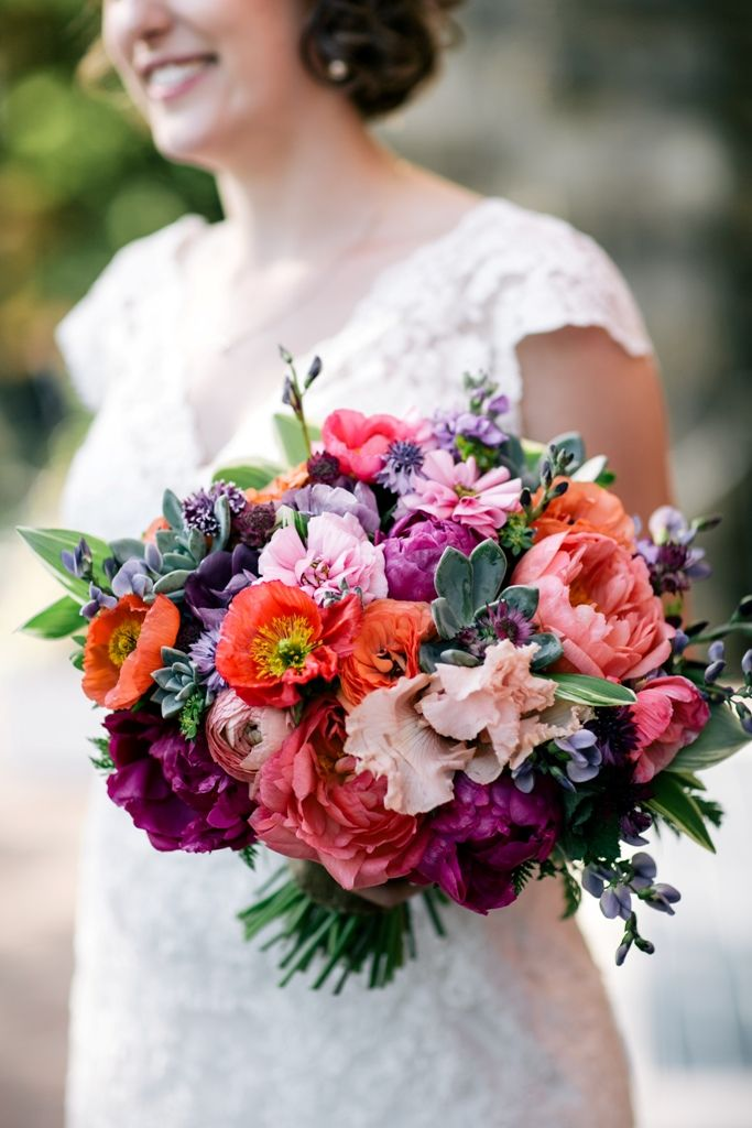 Late spring colorful bridal bouquet featuring peonies and poppies. Grown and designed by Love 'n Fresh Flowers.