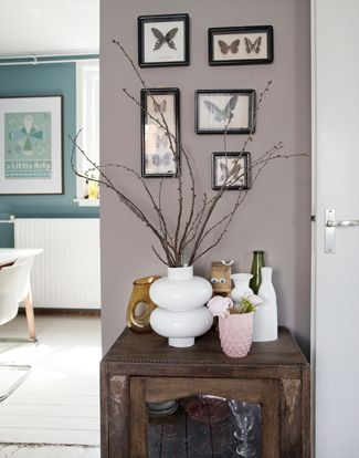 Grayish-purple walls accented with teal, white and yellow... I adore this fresh new palette for Spring.(=