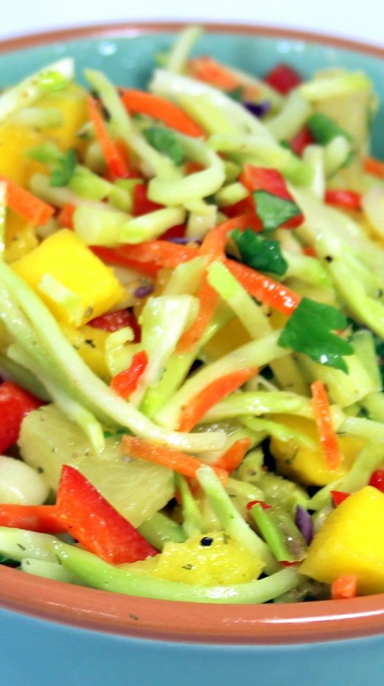 Island Lover Tropical Broccoli COLE SLAW - 52 Grilling Secret Extras Side Dishes... I LOVE LOVE LOVE this Broccoli Slaw recipe loaded with tropical sweet Mango and Pineapple flavors, colorful and a delight STOND OUT dish that makes a table beautiful (and tasty)!
