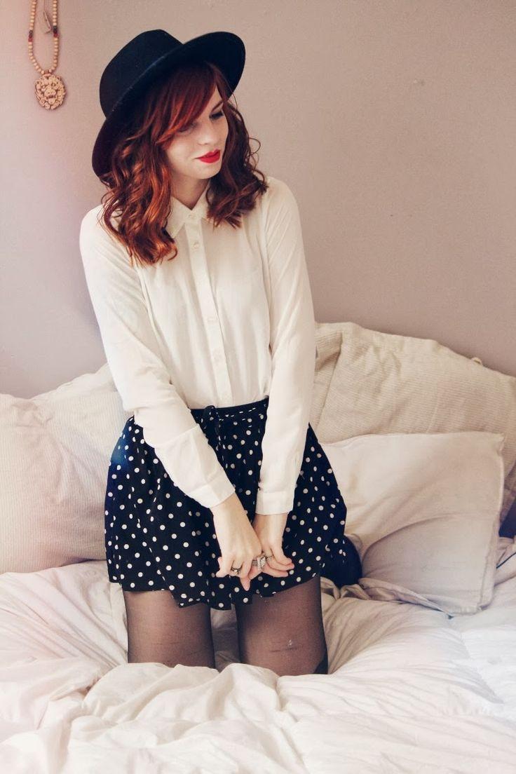 Navy polka dot skirt, white dress shirt & black hat. Spring