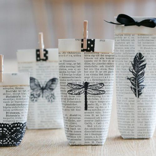 bibliophilebunny:Use pages from an old book, stamp and fold them into small gift bags.