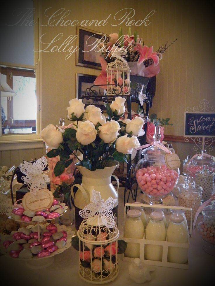 """A gorgeous milk can filled with stunning white/ivory roses and a mini milk crate complete with 6 mini milk bottles with real milk had every guest asking """"is that real milk?""""   www.facebook.com/thechocandrocklollybuffet www.thechocandrock.com"""