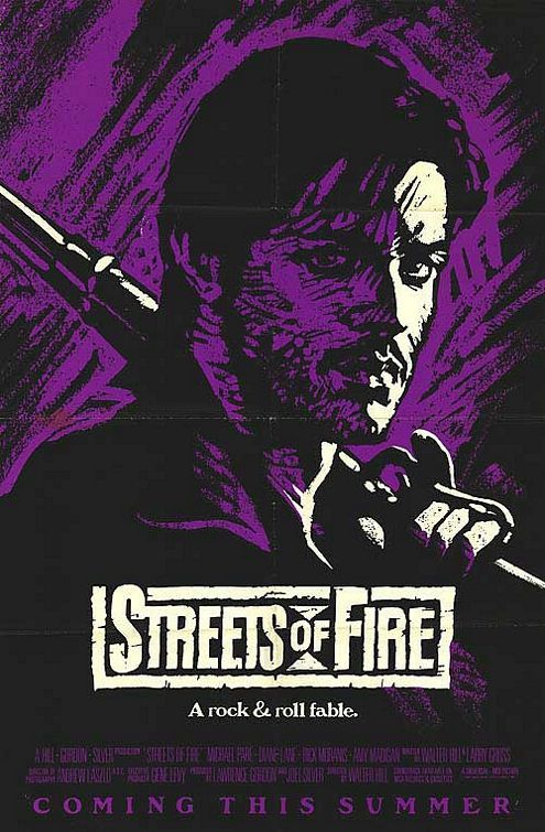 Streets of Fire (1984) directed by: Walter Hill starring: Michael Paré, Diane Lane, Rick Moranis, Amy Madigan