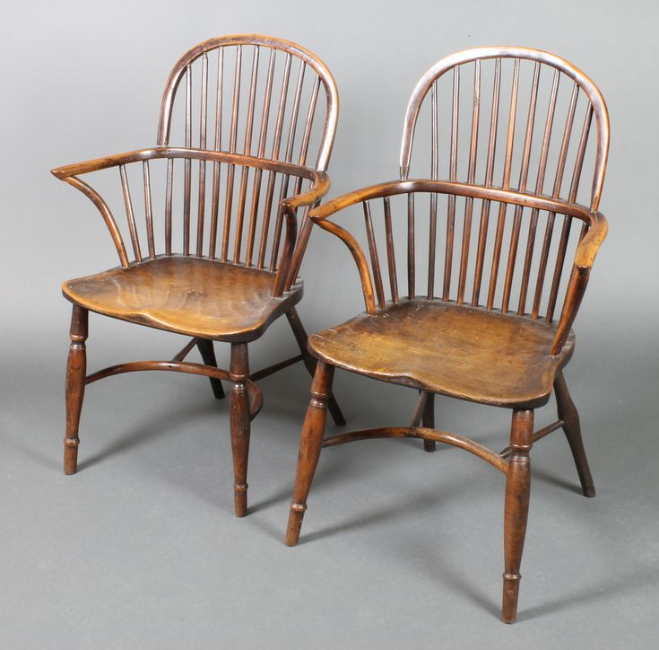 Lot 925, A near pair of 19th Century elm and yew stick and hoop back Windsor chairs with solid seats raised on turned supports with crinoline stretchers est £300-400