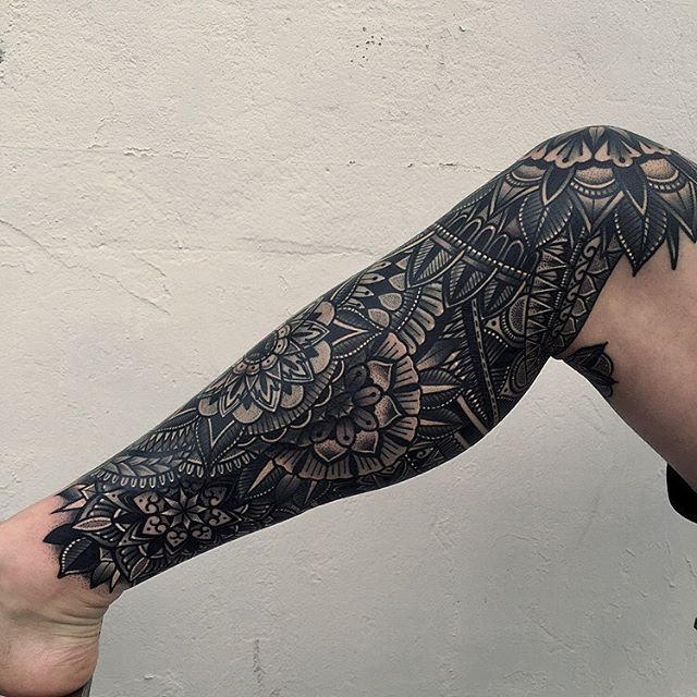 So animals on knees with geometric design leading to mandala(s) on calves