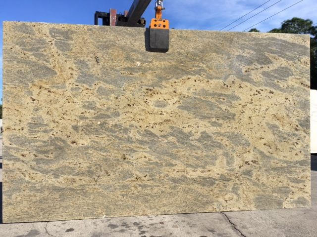 #KashmirGold #granite is low variation #naturalstone with shades of beige, gold, and yellow. A perfect #granitecountertops slab for light or dark #kitchencabinet or #kitchenisland.