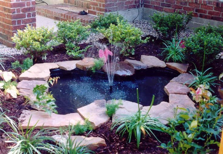 Landscaping and garden pond with fountain Adding A Water Garden To A Landscape