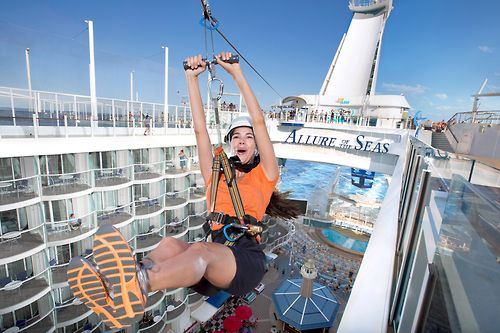 Woman ziplining onboard Royal Caribbean's Allure of the Seas cruise ship