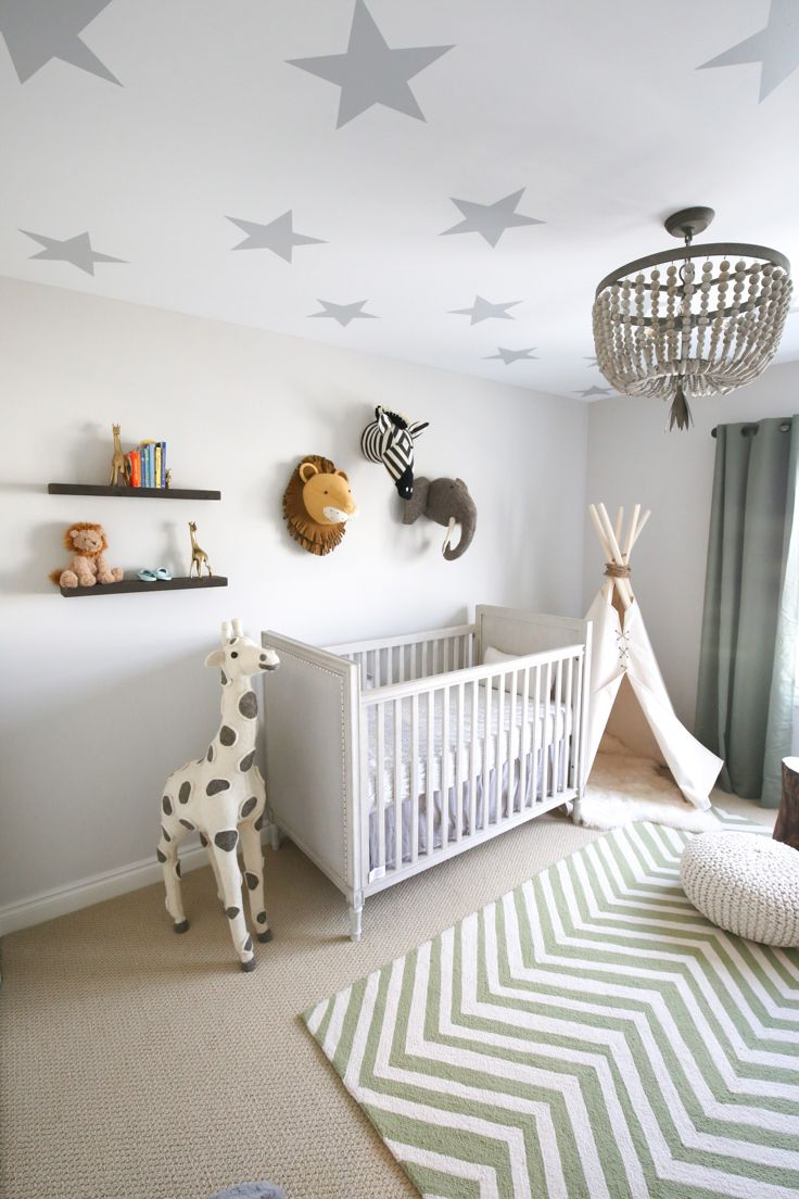 Star wall decals and animal heads in a boy's playful nursery
